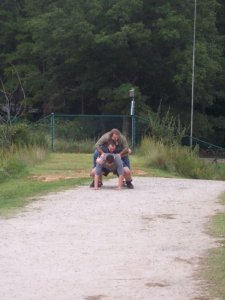 Me and two friends goofing off at a park in NC  Obviously, I'm not the one with the heavy load here.